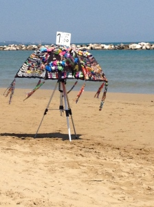 What a clever way to display jewelry and walk on a sunny beach.
