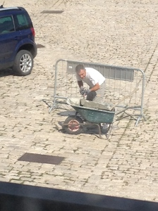 Every cobblestone is solid thanks to this man.  No tripping in our town!